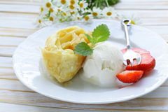 Traditional apple strudel with raisins, served with ice cream Royalty Free Stock Photo