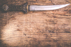 Traditional arab knife. On wooden background royalty free stock photo