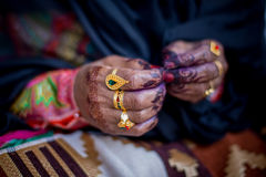 Traditional Arab Lady Hand with Henna. Traditional Arab lady hand with gold jewellery and henna Stock Photos