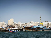 Traditional arabian dhow boats in deira harbour of dubai UAE Stock Photography