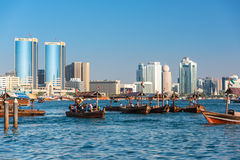 Traditional arabic boats at Dubai creek, UAE. UAE, DUBAI - DECEMBER 27: traditional arabic boats at Dubai creek on December 27, 2014 Royalty Free Stock Images