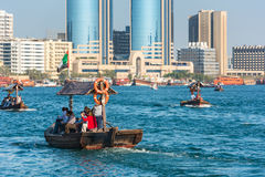 Traditional arabic boats at Dubai creek, UAE. UAE, DUBAI - DECEMBER 27: traditional arabic boats at Dubai creek on December 27, 2014 Royalty Free Stock Photos