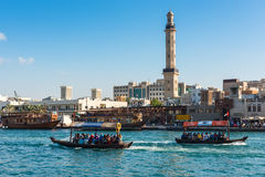 Traditional arabic boats at Dubai creek, UAE. UAE, DUBAI - DECEMBER 27: traditional arabic boats at Dubai creek on December 27, 2014 Royalty Free Stock Photo