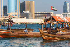 Traditional arabic boats at Dubai creek, UAE. UAE, DUBAI - DECEMBER 27: traditional arabic boats at Dubai creek on December 27, 2014 Stock Images