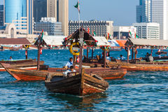 Traditional arabic boats at Dubai creek, UAE. UAE, DUBAI - DECEMBER 27: traditional arabic boats at Dubai creek on December 27, 2014 Royalty Free Stock Image