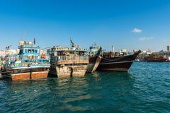 Traditional arabic cargo boats at Dubai creek, UAE Stock Images