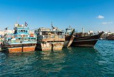 Traditional arabic cargo boats at Dubai creek, UAE Royalty Free Stock Photos