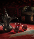 Traditional Arabic coffee. Arabic coffee cups, dates in traditional setting Royalty Free Stock Photos
