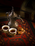 Traditional Arabic coffee. Arabic coffee cups, dates in traditional setting Royalty Free Stock Image