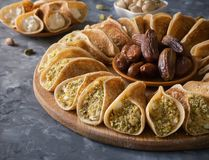 Traditional Arabic crepes stuffed with cream. royalty free stock images