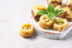 Traditional arabic dessert Baklava with honey and nuts, selective focus. Traditional arabic dessert Baklava with honey and nuts Royalty Free Stock Image
