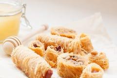 Traditional Arabic dessert baklava with honey Royalty Free Stock Photo