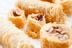 Traditional Arabic dessert baklava with honey Stock Photos