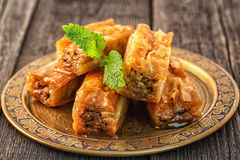 Traditional arabic dessert Baklava with honey and walnuts. Traditional arabic dessert Baklava with honey and walnuts, selective focus Stock Images