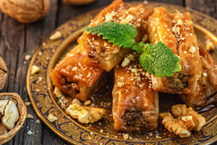Traditional arabic dessert Baklava with honey and walnuts. Stock Photo