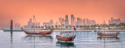 Traditional Arabic Dhow boats in Doha harbour. Qatar royalty free stock photography
