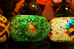 Traditional arabic glass and metal lanterns. Traditional arabic glass and metal colorful lanterns close up Royalty Free Stock Images