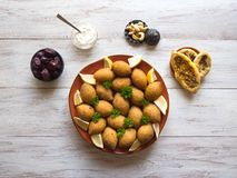 Traditional Arabic kibbeh with lamb and pine nuts stock images