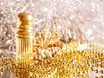 Traditional arabic perfume oil. Perfume oil fragrances in mini bottle on golden and silver  background. Holidays decoration. Chris. Traditional arabic perfume Royalty Free Stock Photos