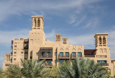 Traditional Arabic Style Building in Dubai. Building with Traditional Wind Towers in Dubai, United Arab Emirates Stock Photo