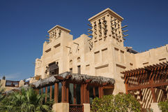 Traditional Arabic Style Building in Dubai. Buildings with Traditional Wind Towers in Dubai Stock Photo