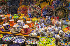 Traditional arabic style culorful cups and plates. At the market. Colored red, yellow, blue, green, violet, pink and white lanterns, decorated with ornaments Stock Photo
