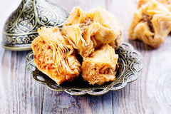 Traditional arabic sweet dessert Baklava. On wooden table Royalty Free Stock Photos