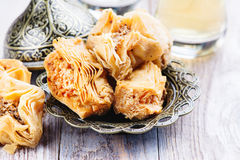 Traditional arabic sweet dessert Baklava. On wooden table Stock Images