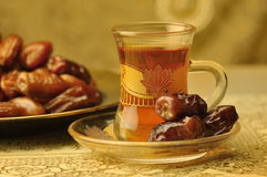 Traditional Arabic tae and dates. Arabic traditional tea cup and dates Royalty Free Stock Image
