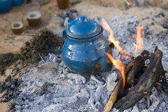 Traditional arabic tea. A traditional mint tea prepared by touareg in desert Royalty Free Stock Photography