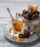 Traditional arabic tea and dry dates Stock Image