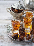 Traditional arabic tea and dry dates Stock Photography