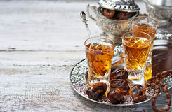 Traditional arabic tea and dry dates Royalty Free Stock Photography
