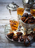 Traditional arabic tea and dry dates Stock Images