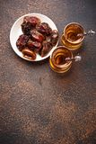 Traditional arabic tea and dry dates. Selective focus Stock Image
