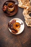 Traditional arabic tea and dry dates. Selective focus Royalty Free Stock Photo