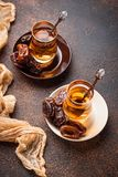 Traditional arabic tea and dry dates. Selective focus Stock Photos