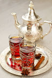 Traditional arabic tea with metal teapot and glasses vertical. Tea on a tray selective focus Stock Images