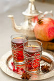 Traditional arabic tea with metal teapot from Morocco and glasse. Tea with spices and pomegranate on a tray selective focus Stock Images
