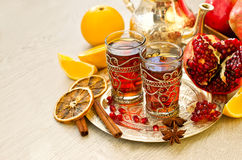 Traditional arabic tea with metal teapot pomegranate and spices. Tea with spices and pomegranate on a tray selective focus copy space Stock Image