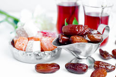 Traditional arabic tea set and dried dates. Stock Photos