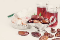 Traditional arabic tea set and dried dates. Stock Image