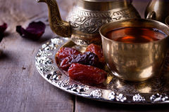 Traditional arabic tea set and dried dates. Stock Images
