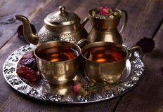 Traditional arabic tea set and dried dates. Royalty Free Stock Photos