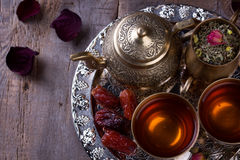 Traditional arabic tea set and dried dates. Royalty Free Stock Image