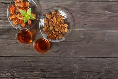 Traditional Arabic, Turkish Ramadan tea with dry dates and raisins on a wooden black table. Ramadan. Turkish fresh tea with dates. View from above Royalty Free Stock Photo