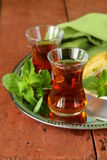 Traditional Arabic Turkish tea served with mint Royalty Free Stock Images
