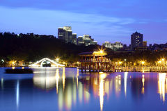 Traditional arch bridge and oriental pavilion by the lake. ~ night scene of a lakeside park in Taipei Taiwan ~ Dahu Community Park in Taipei City, Taiwan Stock Photos