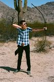 The Traditional Archer with a long bow in the desert Stock Photos