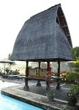 Traditional architecture balinese resort. Poolside pavilion shelter - A photograph image showing the recreation pool side area pavilion of a bali holiday resort Stock Images